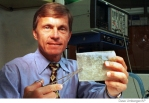 Dr. Stephen F. Badylak holds material extracted from pig intestine that would be used to replace damaged human ligaments in a 1997 file photo.
