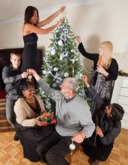 10761444-happy-family-decorating-together-the-christmas-tree