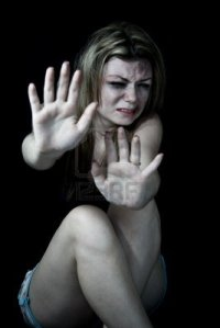 12669756-stop-violence-women-scared-and-beaten-white-woman-pretending-holding-out-her-hands-in-the-stop-posit